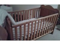 Cot Bed, wooden, with a mattress and duvet cover both in very good condition.