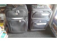2 skylite black suitcases