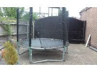 9 ft Trampoline and safety net.