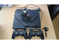 ps3 console with games controllers and headset