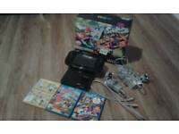 Nintendo Wii U 32gb with 4 games, as new
