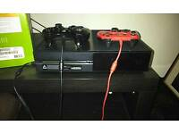 Xbox one with two control pads aren't wireless and a couple of games