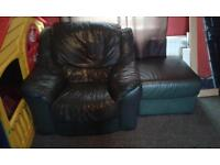free green leather arm chair and matching foot rest