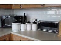 Tea coffee sugar and buiscuit jars