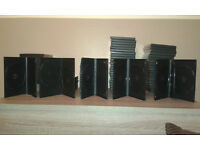 assortment of dvd/cd cases/ink/blank discs/