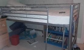 Single raised bed frame with matress and storage area underneath
