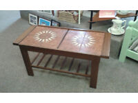 Vintage tiled coffee table with extending sides and magazine rack shelf. Lovely tulip tiled design.