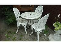 Garden Table and three chairs.
