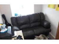 Small brown leather sofa.
