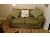 Almost new three seater and two seater suite for sale