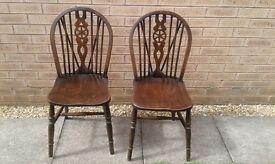 2 wheelback dining chairs. Wooden, used but sound!