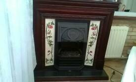 Dark wood ,tile surround electric convector fire