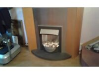 Fire surrond wooden with granite base including electric fire with white pebble effect