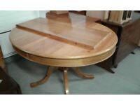 PINE EXTENDING ROUND DINING TABLE £45.00