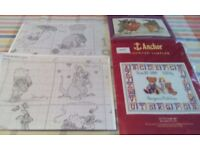Three cross stitch charts. The lion king, Teddy ABC sampler, Pooh and Friends calender.