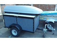 Trailer with looking lid & looking top box