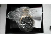 new and sealed Accurist gold watch