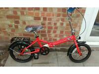 Brand new Genuine Ford folding bike. Unusual and in the official Ford red.