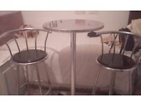 Bar table with two bar stools