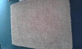 Sumptuous shaggy deep pile natural wool sand coloured rug
