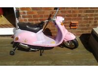 Girl's pink electric scooter