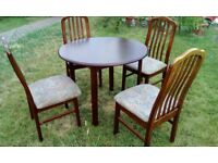 3 foot diameter mahogany effect round table with 4 chairs
