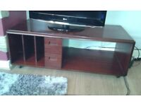 Solid wood TV unit on casters for easy repositioning