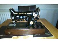 Old singer sewing machine in original carrying case