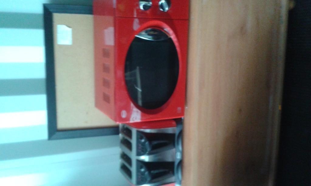 microwave and large toaster setin CaerphillyGumtree - Microwave and large toaster set in red, picture shows marks on microwave which iv cleaned off although there are a few stains inside, good condition