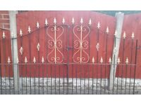 Wrought iron gates together 8ft wide highest 6ft