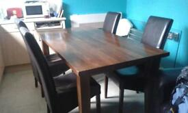 solid oak table and 4dining chairs