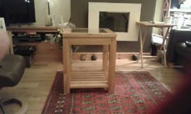 A beautiful solid oak glass topped side table. Excellent condition.