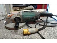"Makita 9069 9"" grinder 110v with diamond cutting blade"