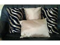 Four Lovely Oblong Navy/Gold pattern Cushions.