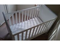 White wooden cot with mattress and rail protectors