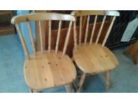 2 pine spindle back dining chairs £45.00