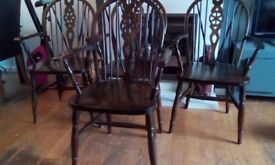 solid wood wheelback carver chairs £15 each