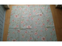 Pair of light blue curtains with flower pattern