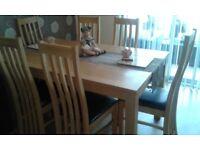 Dinning table and six chairs,