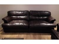 4 seater and 3 seater dark brown leather sofas and footstool.