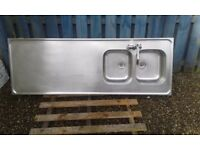 Commercial style stainless steel double sink and drainer with mixer tap. Used but good condition.