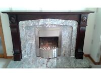 Marble fireplace, Hardwood surround and electric fire.
