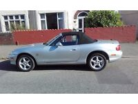 Silver Mazda MX5 with very low mileage + boot rack