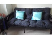 Black Upholstered Double size Futon. Very good condition and solid metal frame
