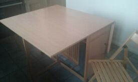 Space saving Oak effect dining table and 4 chairs