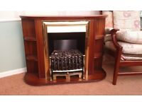Electric fire with wooden and brass effect surround.