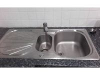 One and a half kitchen sink and mixer tap