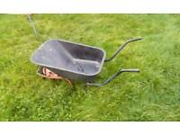 Sturdy wheelbarrow. Buy or hire for your DIY project