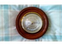 Barometer in wooden surround