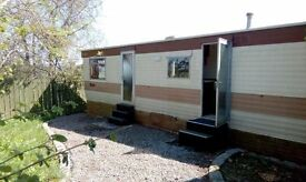 Residential Caravan with private garden area and shed